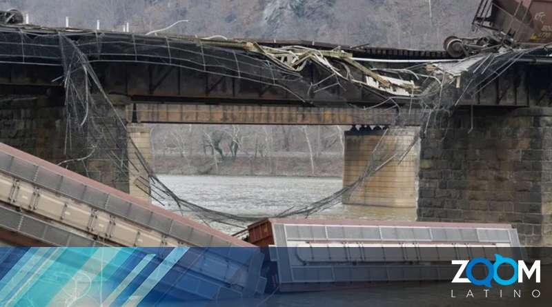 Descarrilamiento de un tren de carga provoca que dos vagones caigan al agua